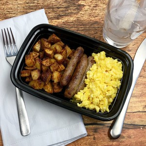 Scrambled eggs, sausage links and roasted redskin potatoes